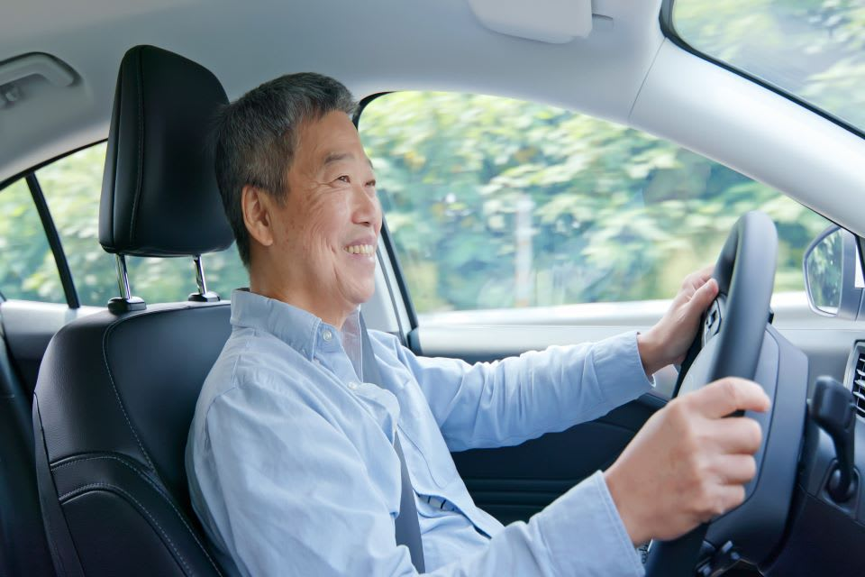 Elderly man driving.