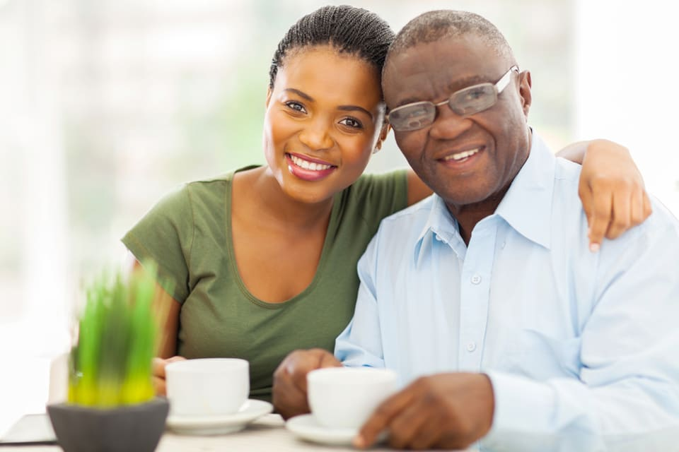 Daughter and father enjoy coffee together.