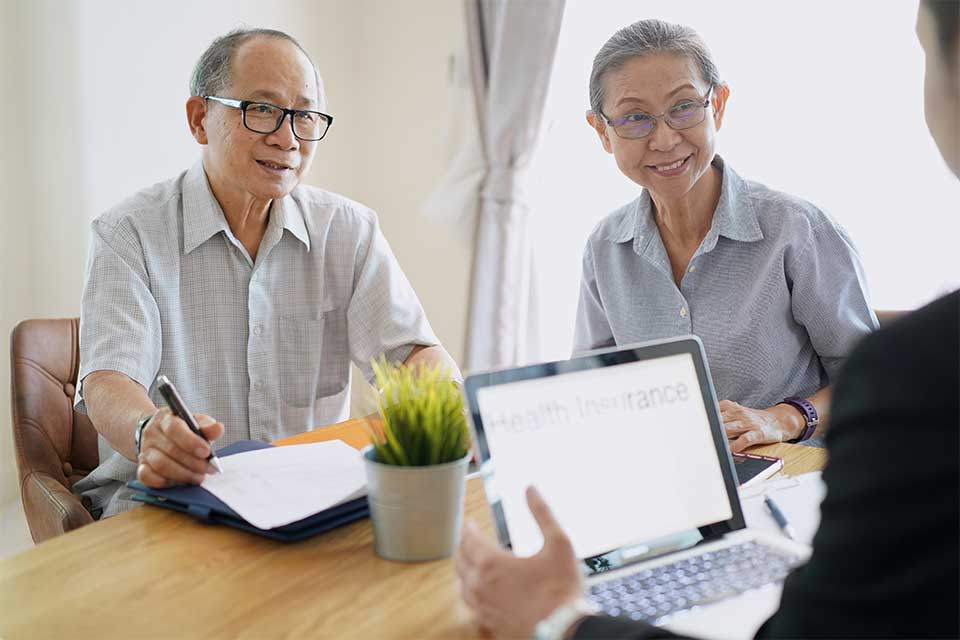 Elderly couple working with their geriatric care manager to make senior care plans.