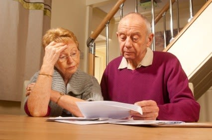 Older couple looking at legal documents
