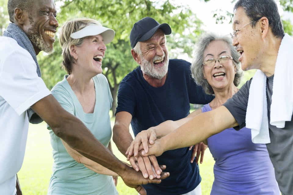 Group of active older adults teams up to enjoy exercising outdoors.