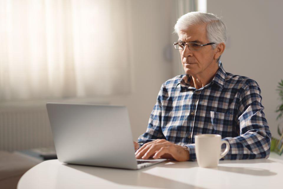 Elderly man filing taxes