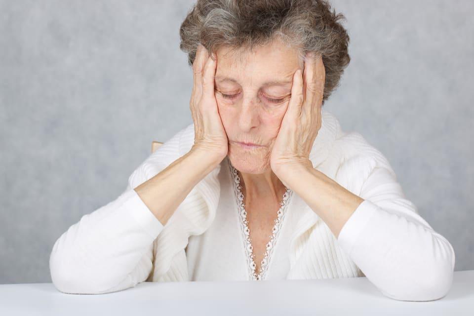 Sad and worried elderly woman