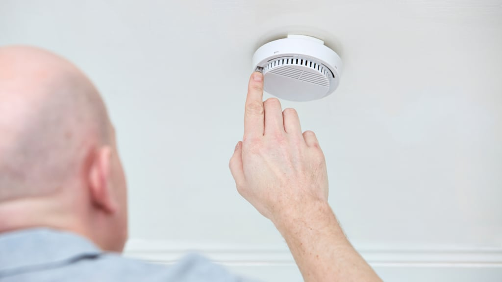 checking smoke detectors is part of how to winterize a vacation home