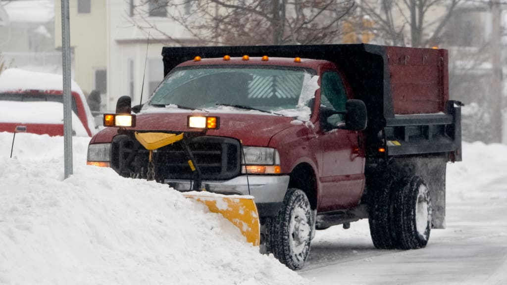 Add snow plowing to your winter home checklist for Hamptons winter home preparations