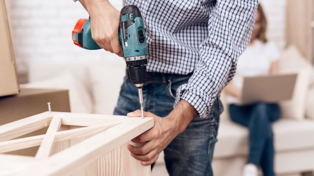 A man doing carpentry work as part of handyman services list