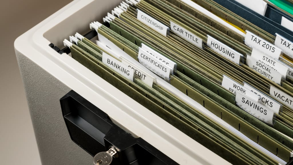 an organized filing cabinet thanks to tips on home organization