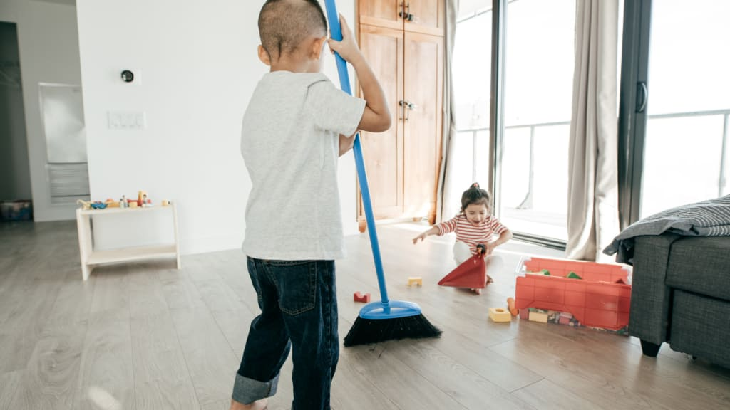two toddlers work on age appropriate chores for kids to do