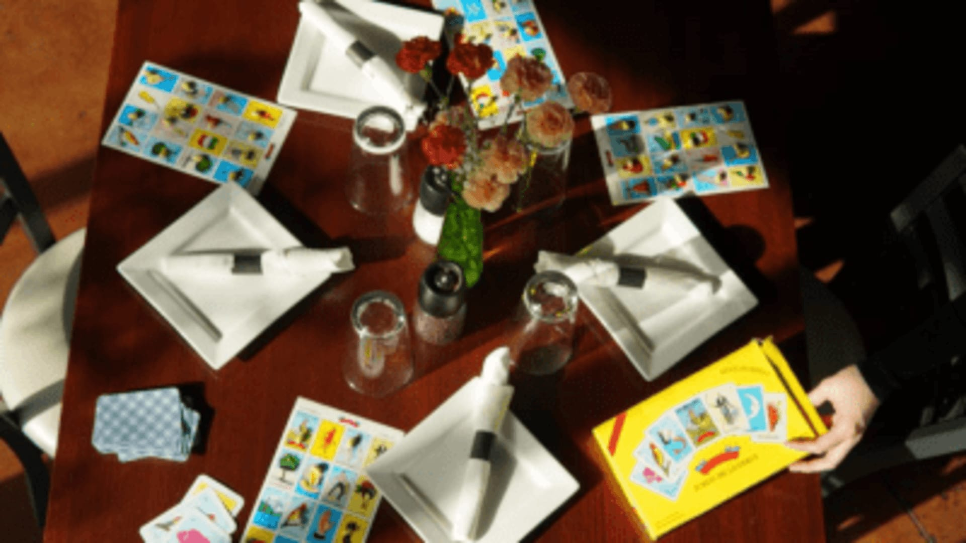 mexican grill table footage with plates and mexican games for exhibition