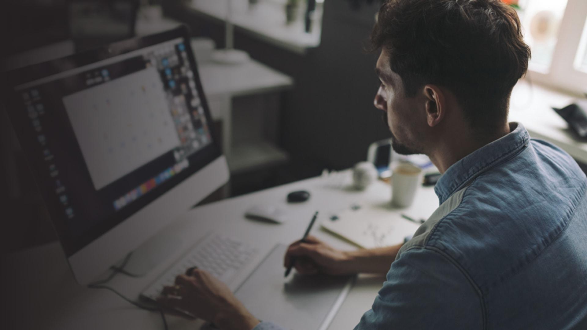 young men designer working in desk