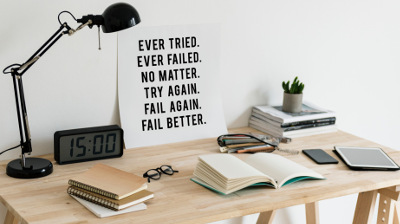 Desk with Poster saying Ever Tried, Ever Failed, No Matter, Try again, Fail Again, Fail Better