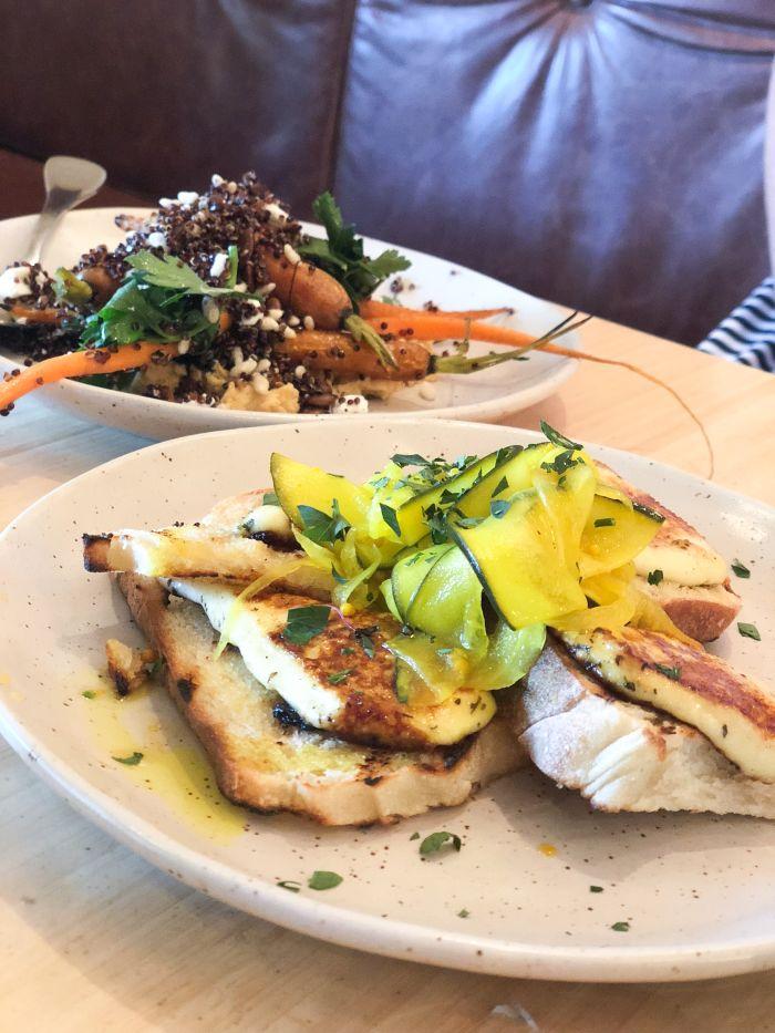 Halloumi on toast with quinoa and roasted veg salad