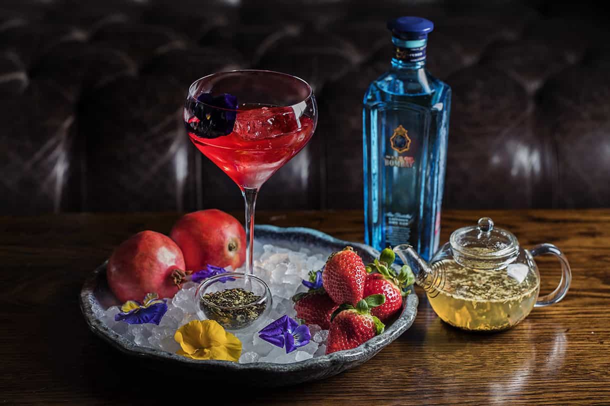cocktail drink garnished with edible flowers
