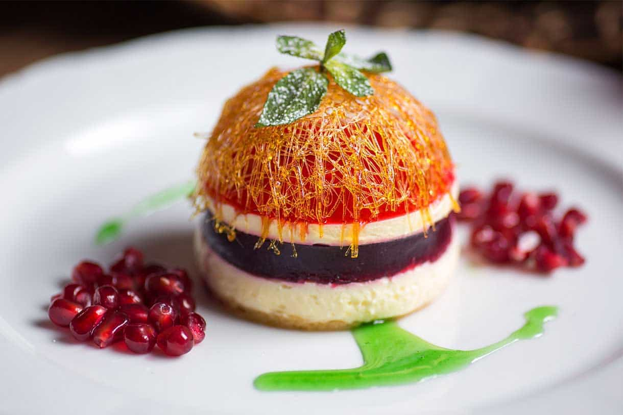 close-up of cheesecake with pomegranate