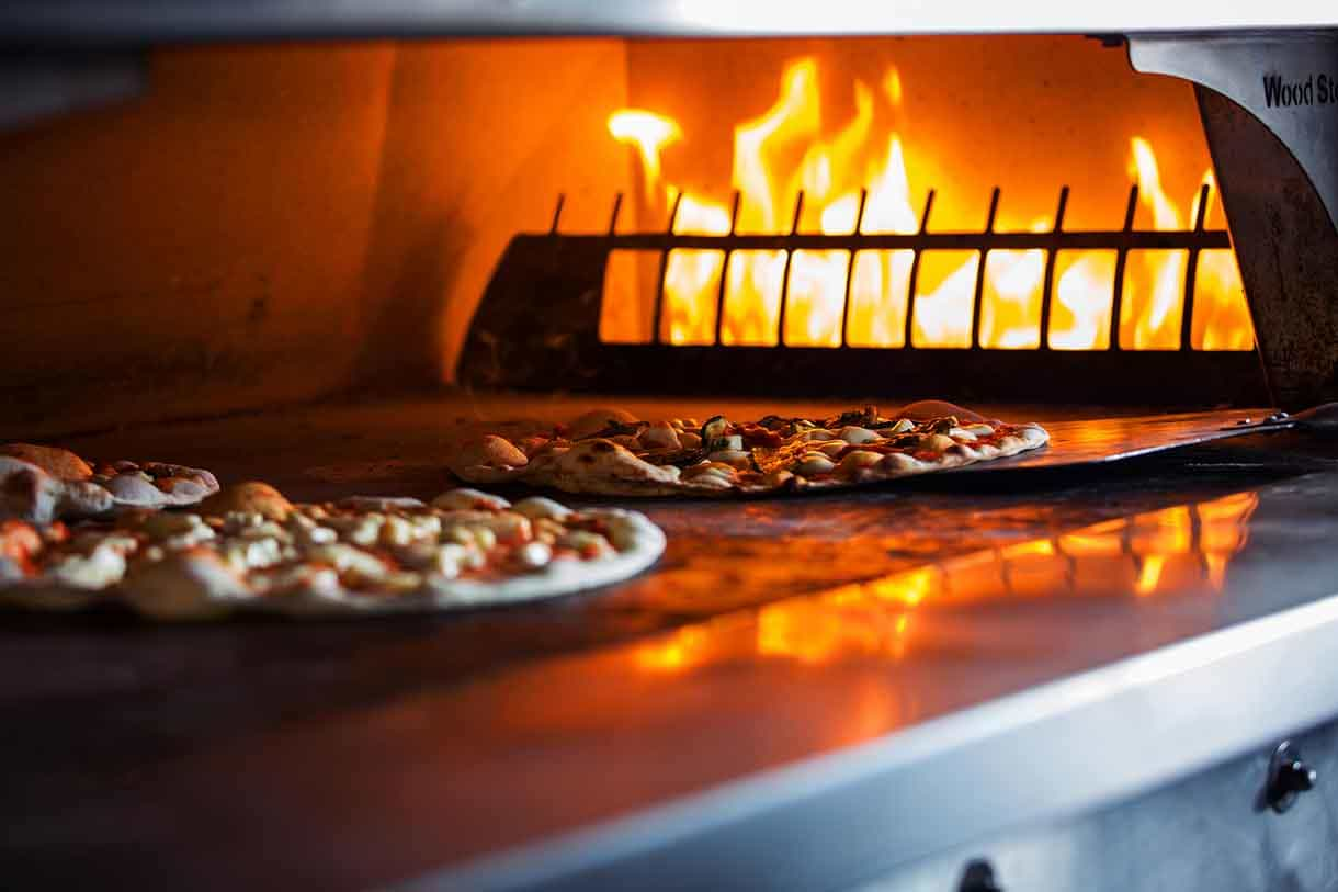 pizza in an wooden fired oven