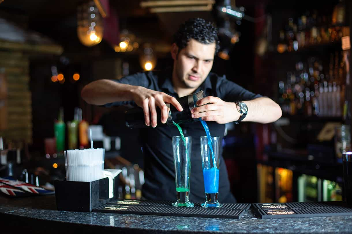 bartender making 2 cocktails simultaneously