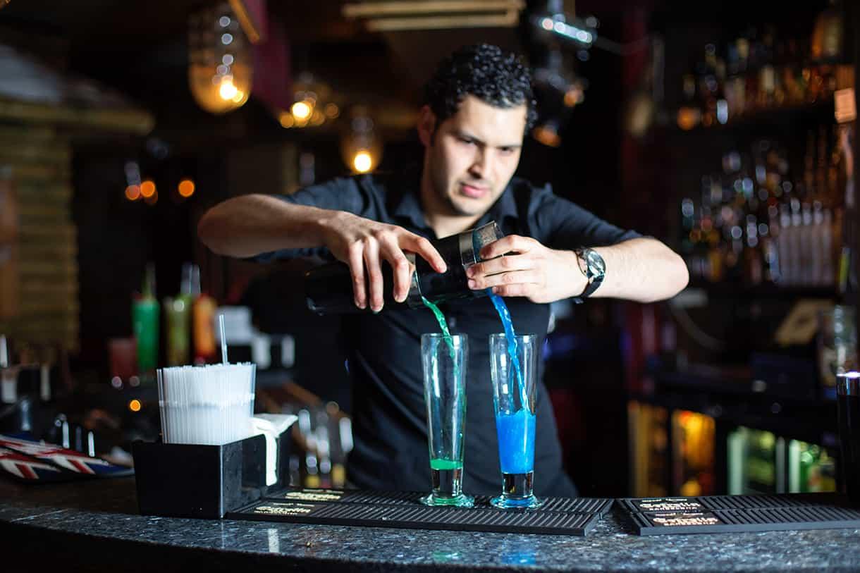 bartender making 2 cocktails simultaneously