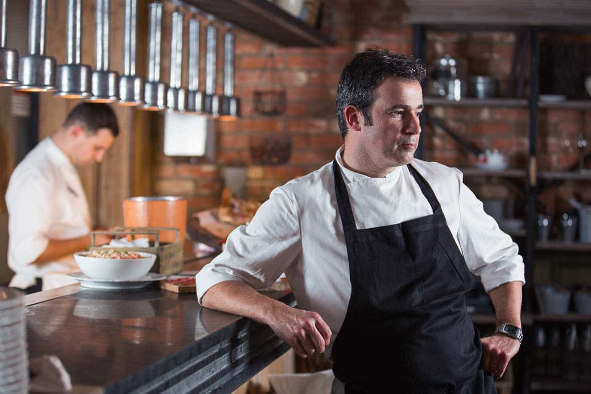 portrait of a chef with pensive look