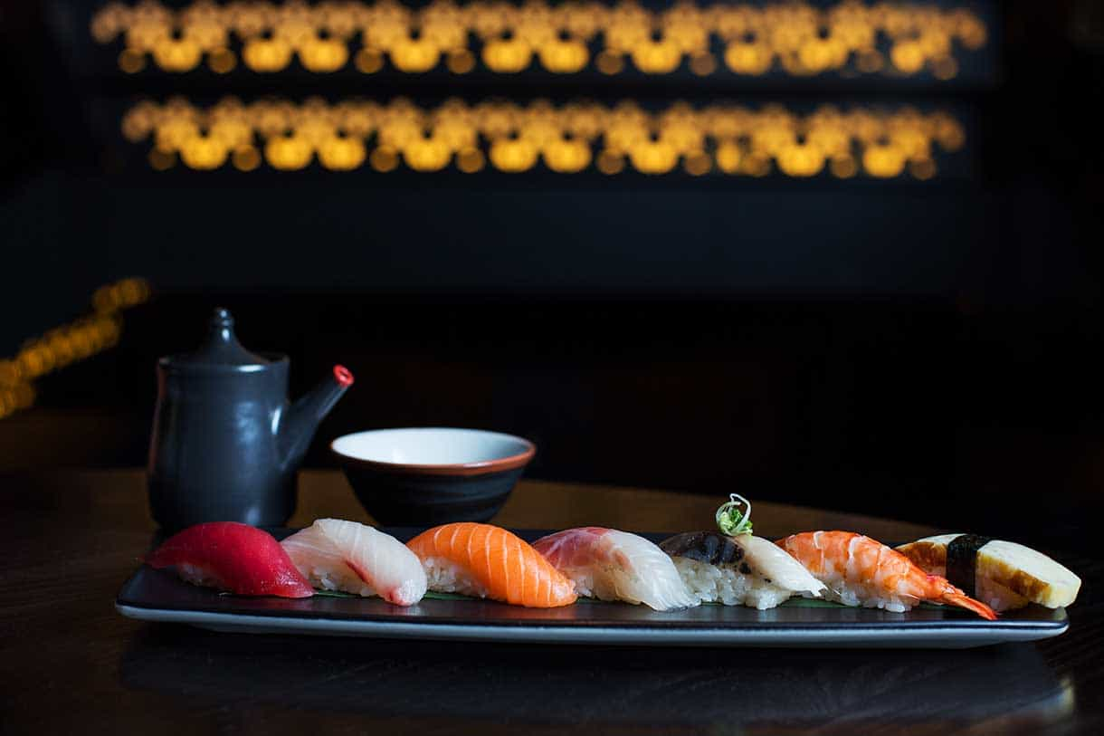nigiri platter with soya sauce on a side