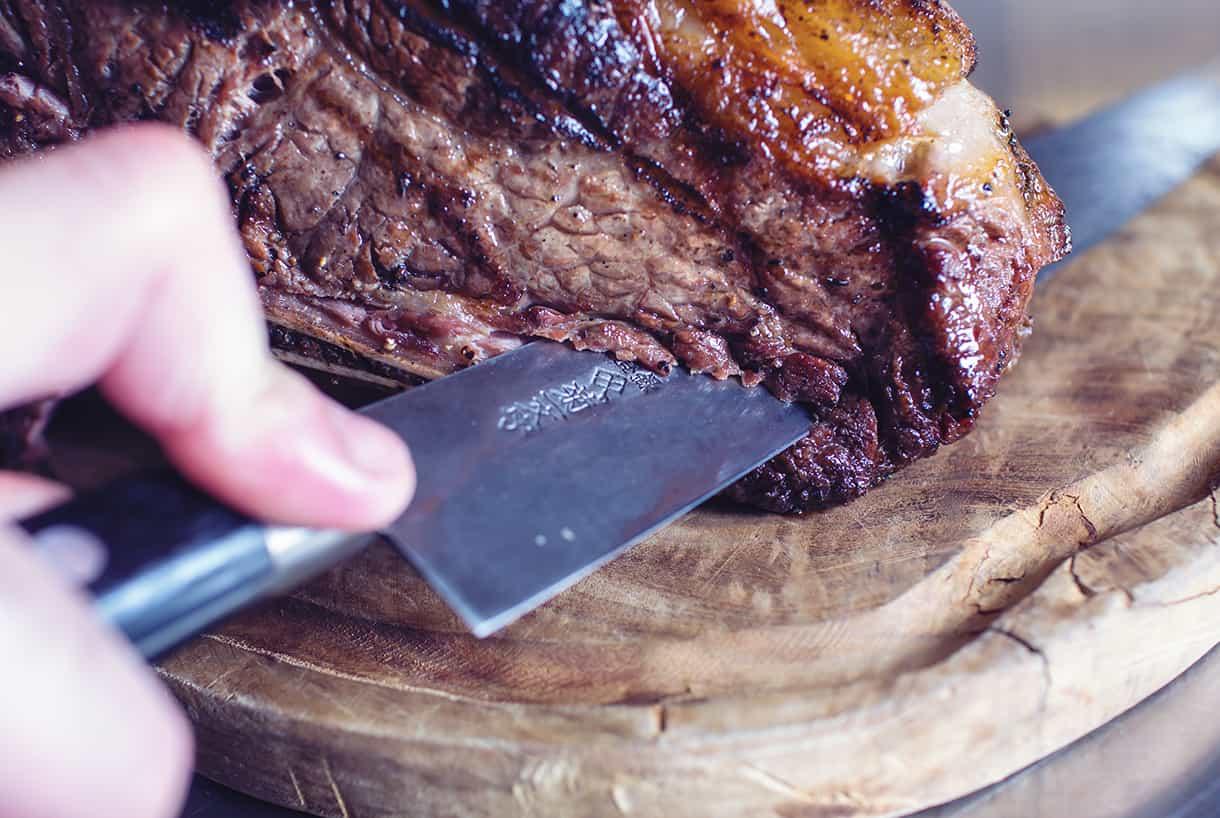 chef slicing steak close-up