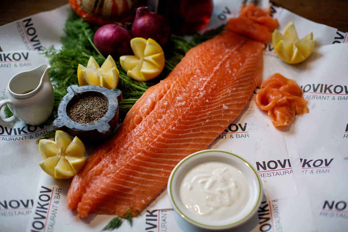 smoked salmon with sour cream on a side