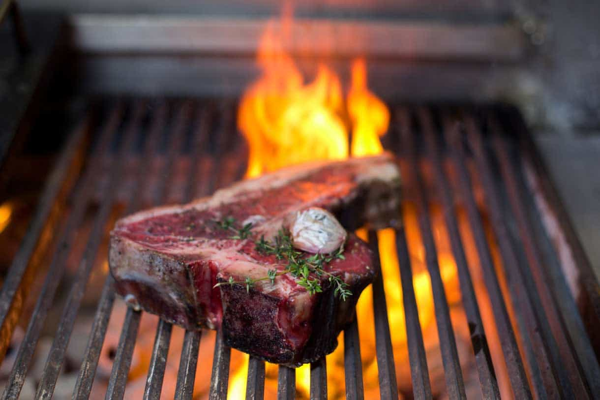 T-bone steak on a grill