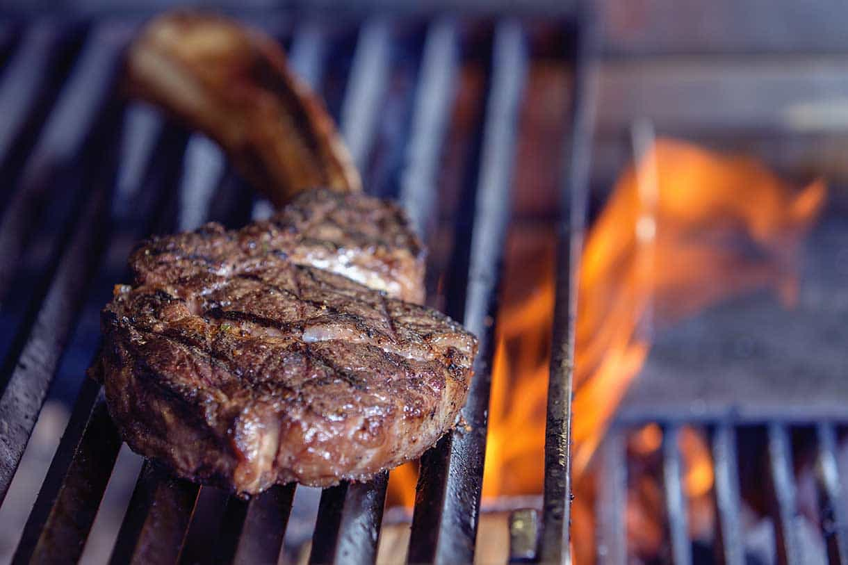 tomahawk beef steak on a fired grill
