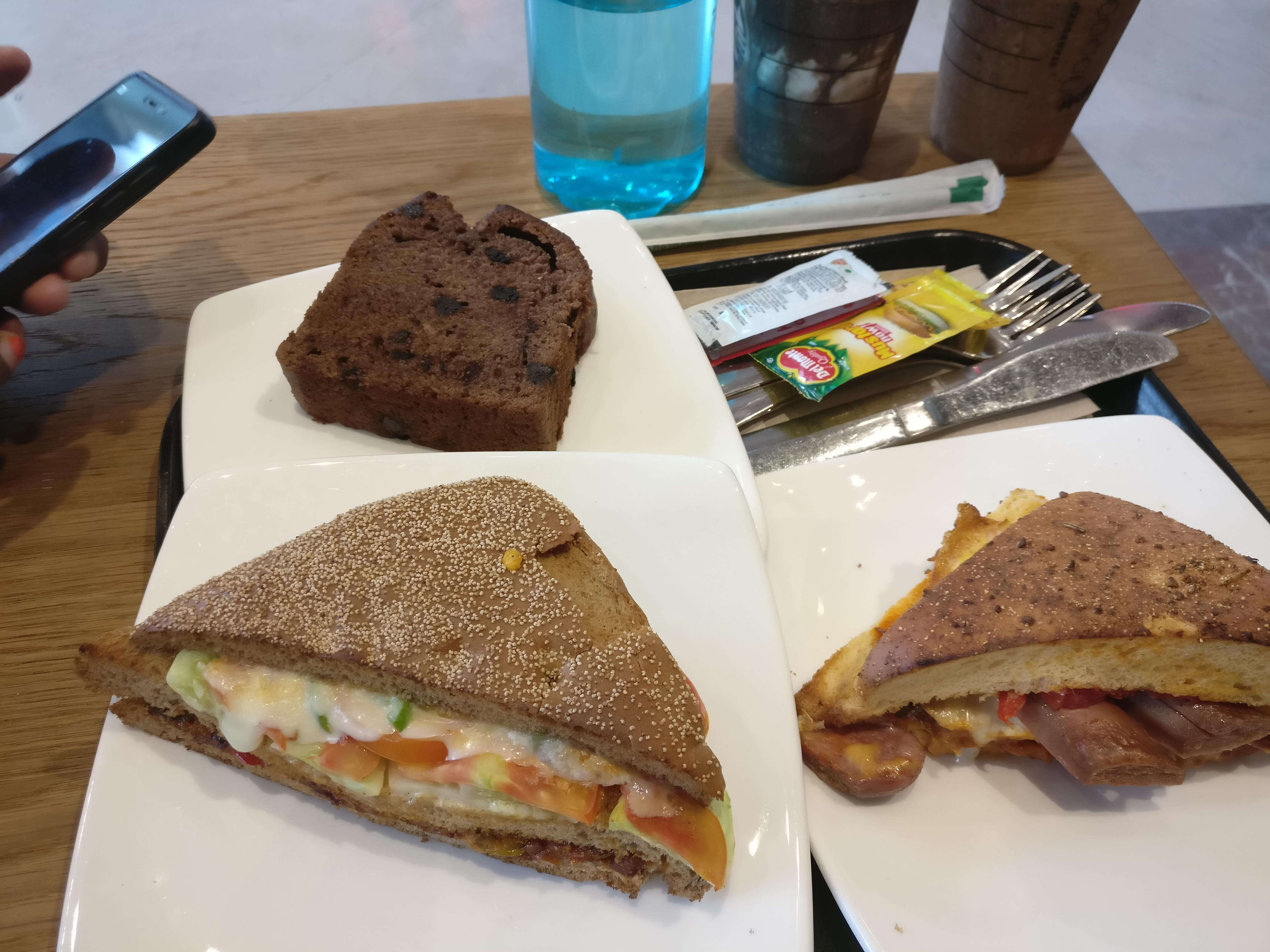 Chicken Club Sandwich, Double Meat Club Sandwich, and Banana Chocolate Cake
