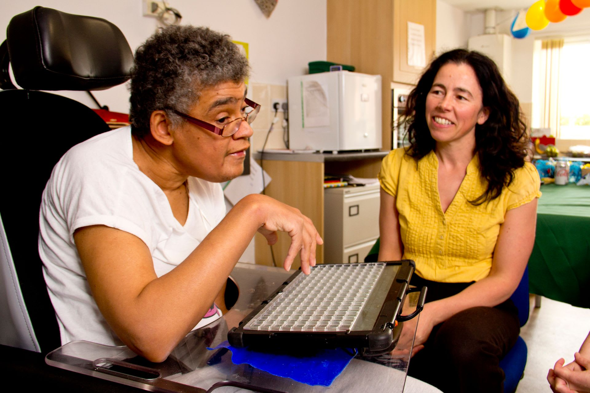 cover photo of client and clinician using AAC