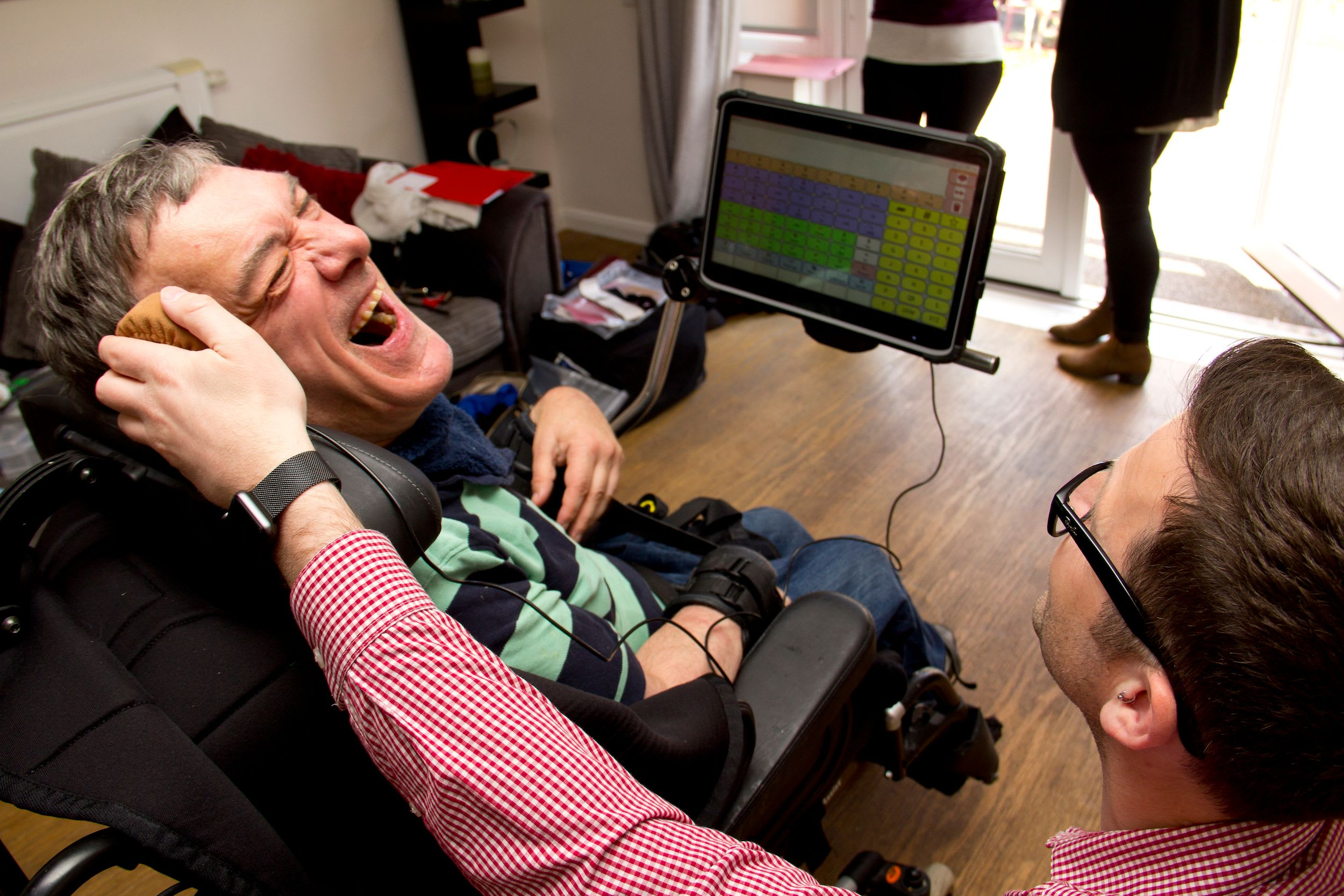 Client getting fitted with a new AAC device