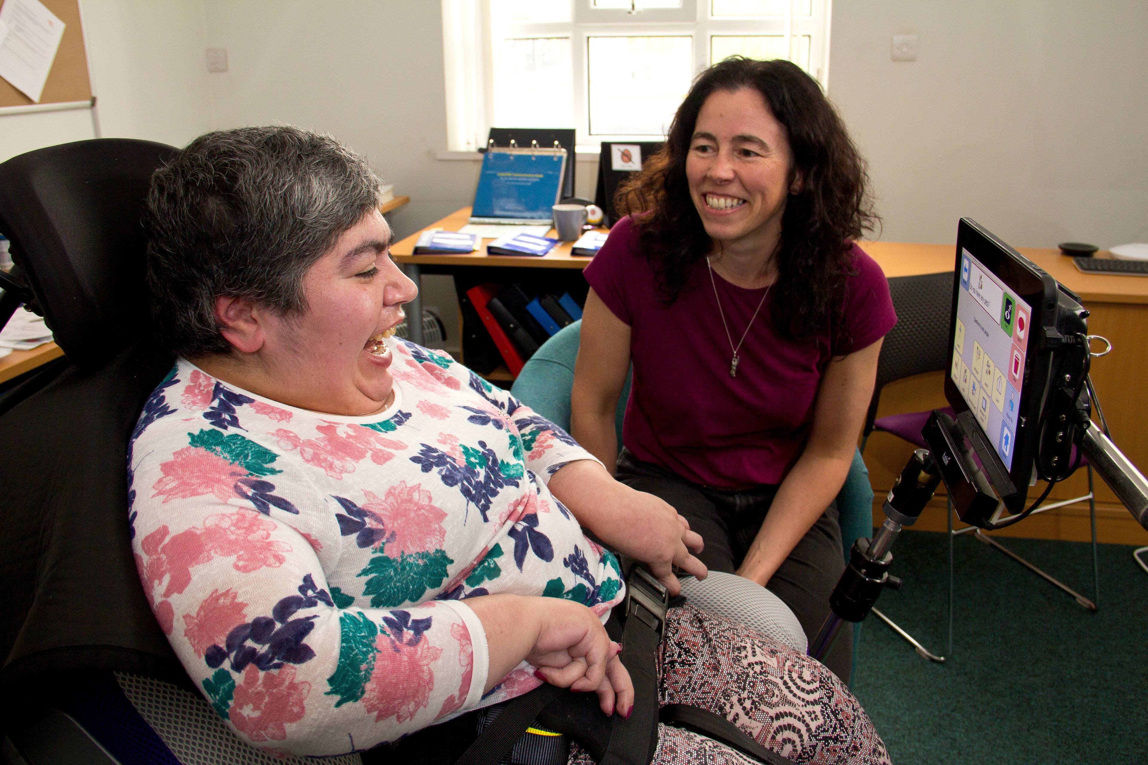 Ace centre employee and client laughing