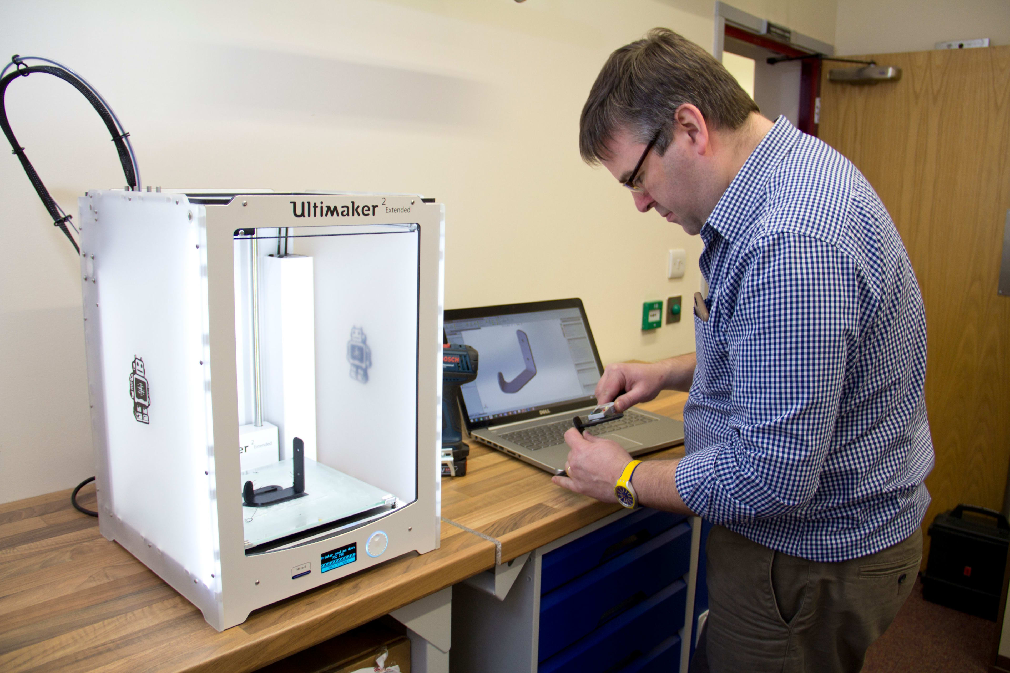 An Ace Centre engineer using a 3D printer