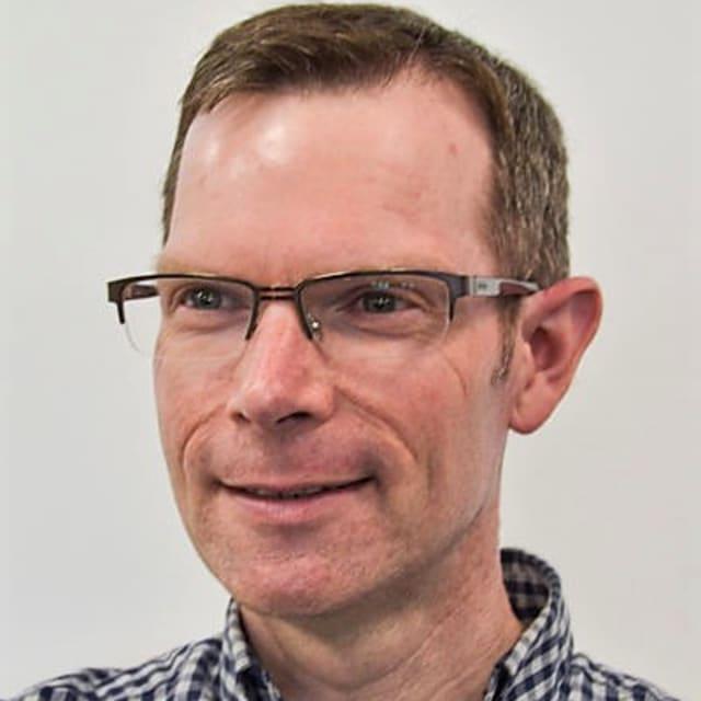 Head shot of Simon Bull