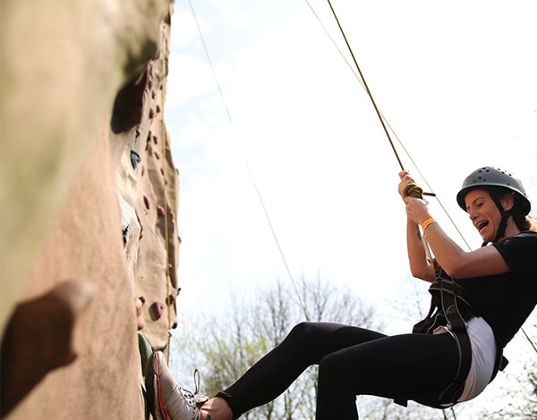 a woman abseiling at Ackers Adventure