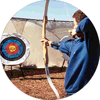 Man Aiming at an Archery Target