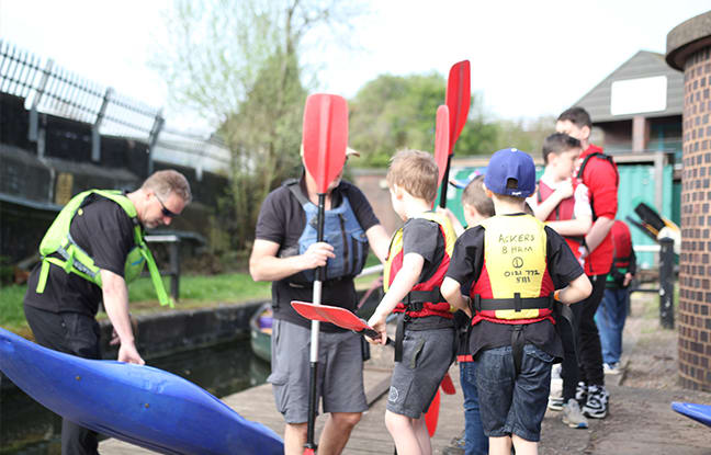 Children getting ready to do a group Kayak lesson