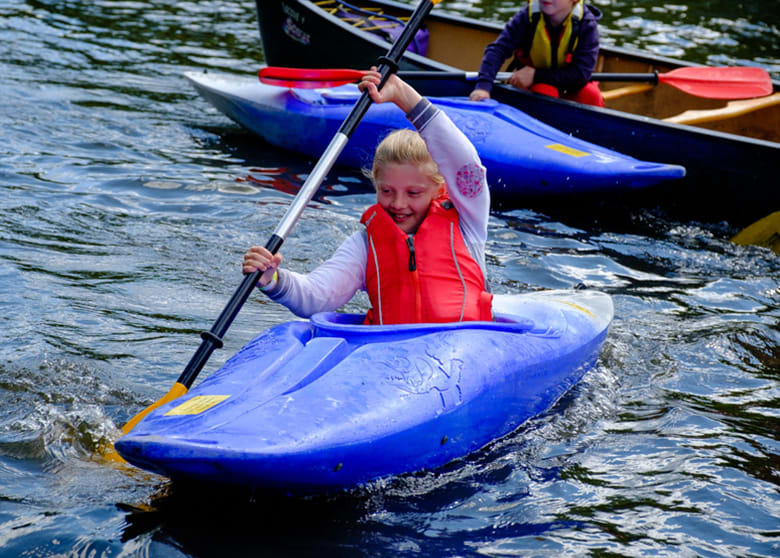 A young girl Kayaking in the canal