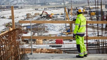 A worker takes a wide look at a construction site.