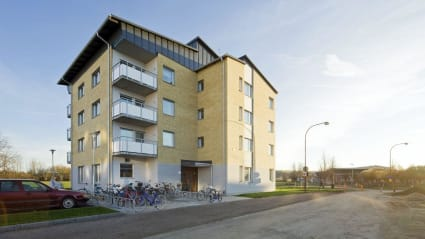 NCC: Folkboende i Mejerskan, med gulbeige fasad och