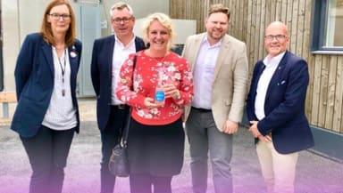 Medverkarna i Stadspodden poserar för en bild.