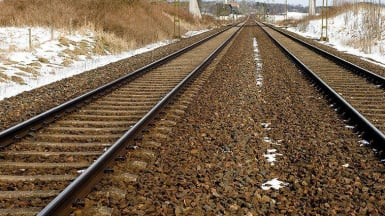 A view of slightly snow covered tracks running into the distance.