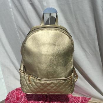 Mochila color oro
