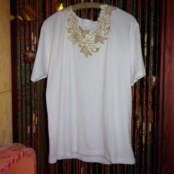 Blusa de algodón tejido con aplicaciones doradas