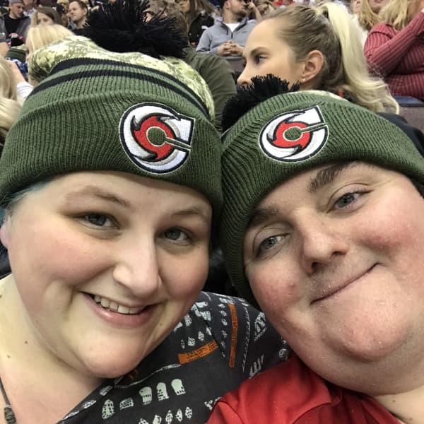 At the Cincinnati Cyclones Hockey game in matching hats!