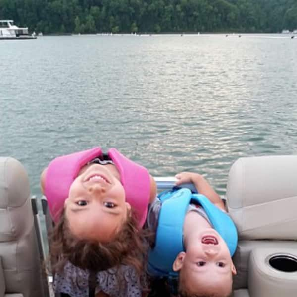 Silly kids on the boat