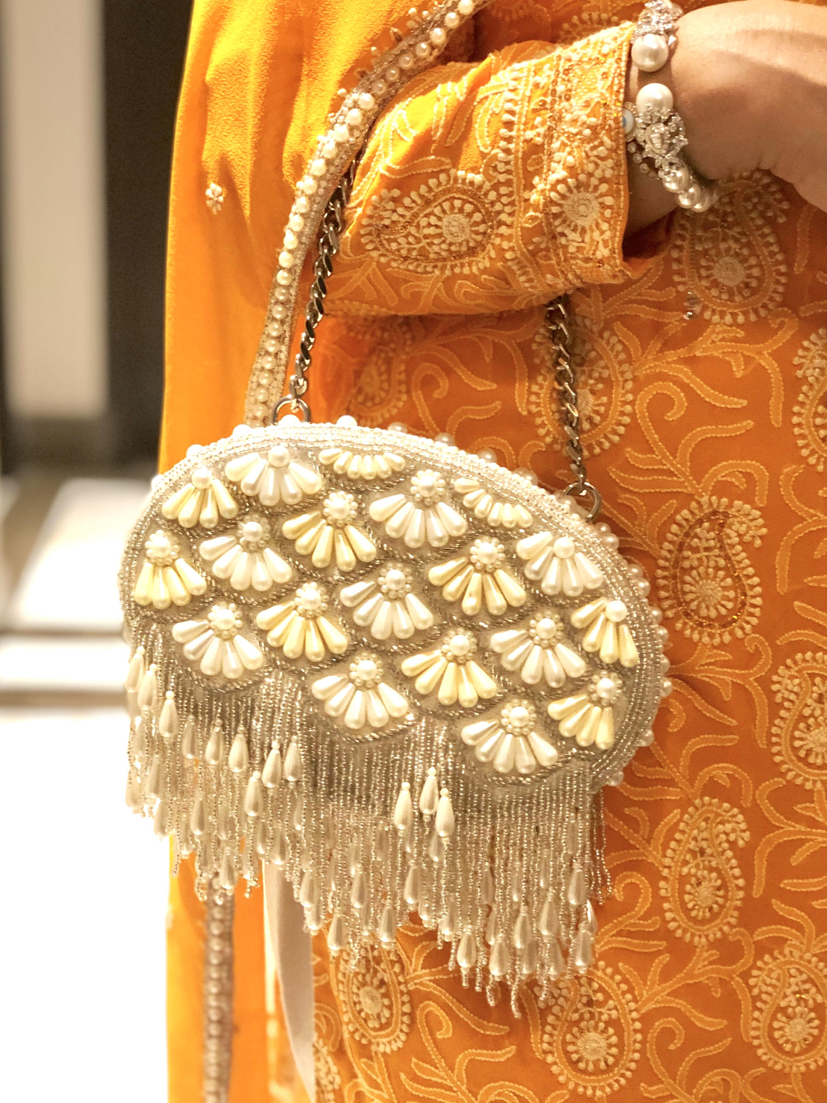 CREAM FAREEDA CLUTCH BAG image 1