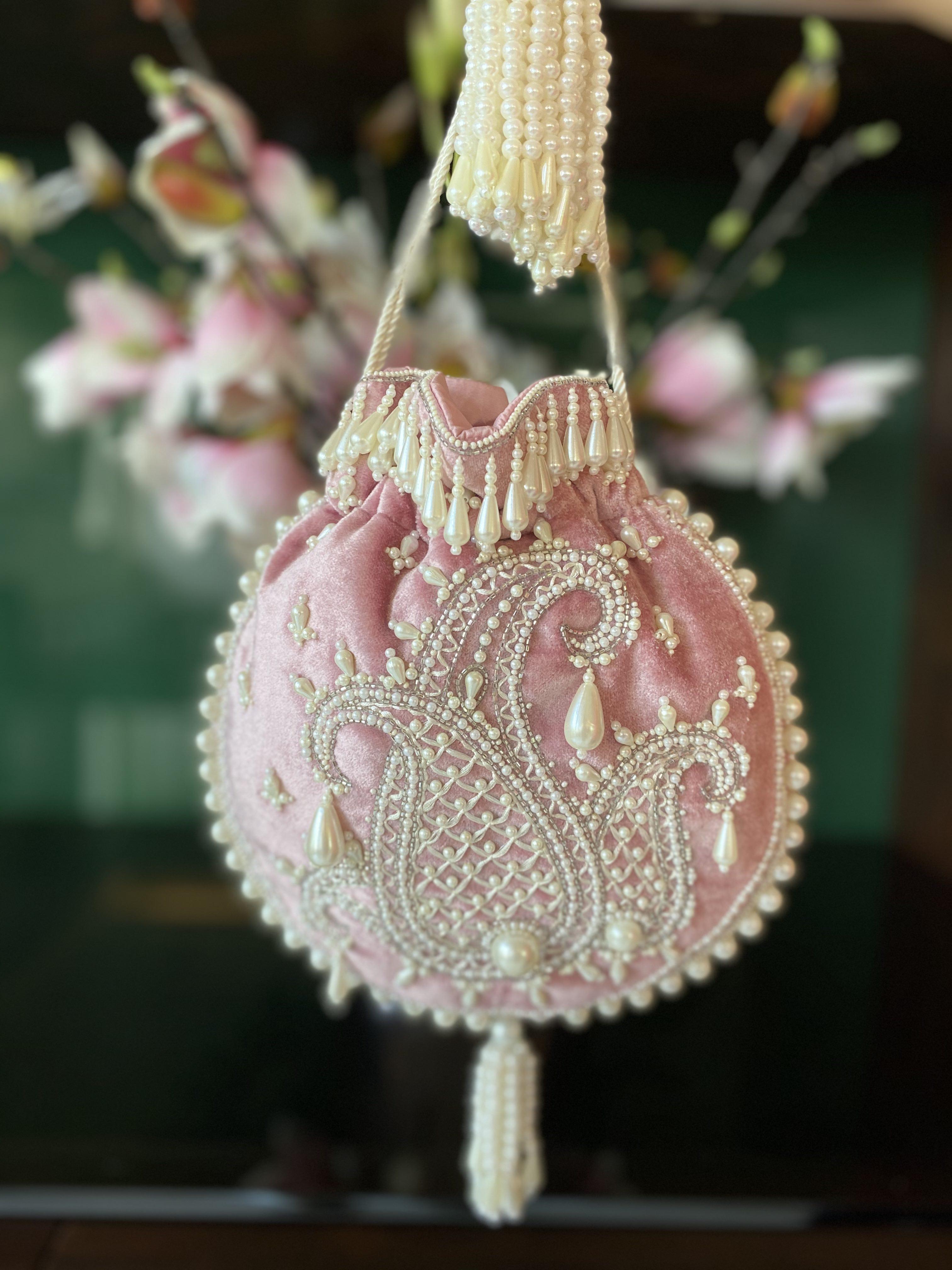image of PINK AMBI PEARL BAG