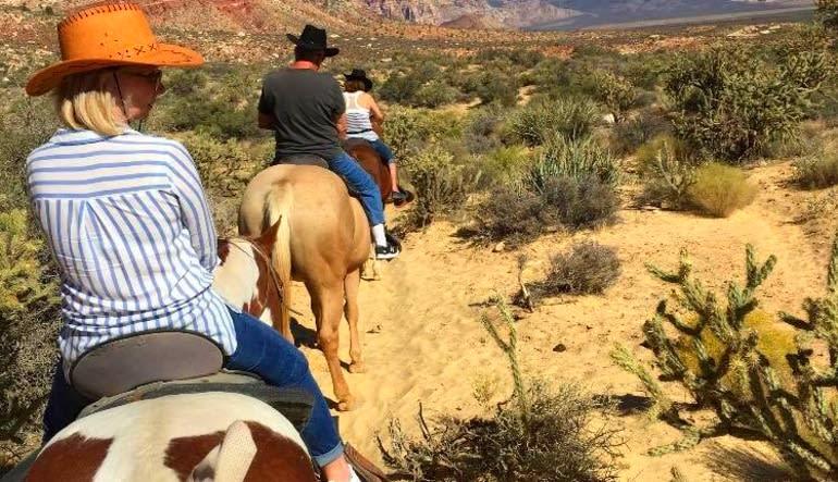 =Wild West Horseback Riding Las Vegas  Behind