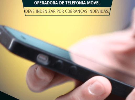 Operadora de telefonia móvel deve indenizar por cobranças in