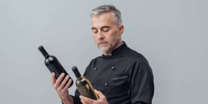 Wine Professional Deciding Between Two Wines